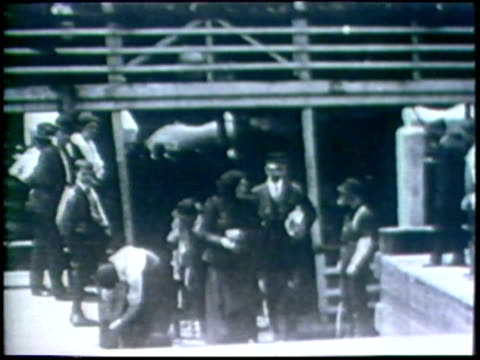 1973 b/w montage ms boat arriving in dock/ ws immigrants disembarking/ usa/ audio - immigrant stock videos & royalty-free footage