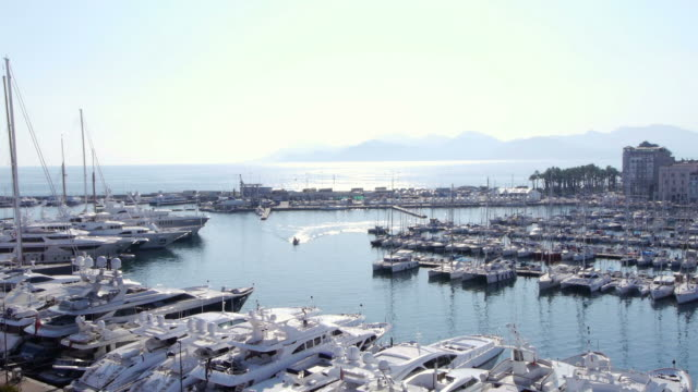 boat arriving in harbor entrance of cannes, france - 1 minute or greater stock videos & royalty-free footage