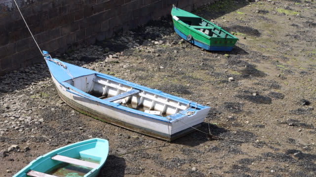 boat at low tide in brittany - low tide stock videos & royalty-free footage