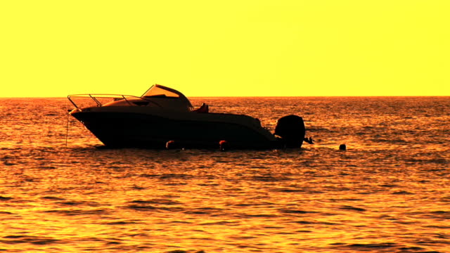 hd: boat at sunset - anchored stock videos & royalty-free footage