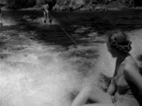 female male water skiing behind motor boat male crossing over wake summer recreation fun leisure nevada arizona reservoir national recreation area - 1952 stock videos & royalty-free footage