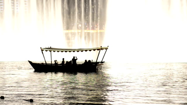 boat beside the dubai fountains - fountain stock videos & royalty-free footage
