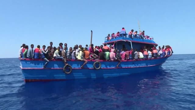 a boat carrying 272 migrants mostly eritreans is rescued by the ngo mediterranean sos around 20 nautical miles off the coast of libya - libya stock videos and b-roll footage