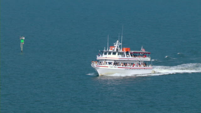 A boat carrying tourists cruises in the Gulf of Mexico.