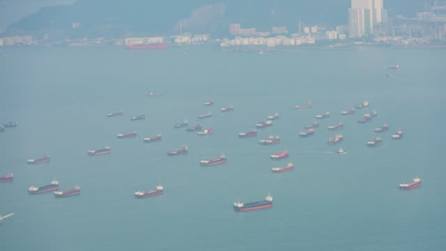 boat container ship at hong kong - south china sea stock videos & royalty-free footage