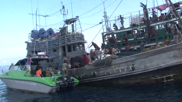 a boat crammed with scores of rohingya migrants including many young children was found drifting in thai waters thursday with passengers saying... - songkhla province stock videos and b-roll footage