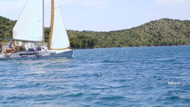 ws boat crew navigating a sailboat on the sea - equipaggio video stock e b–roll