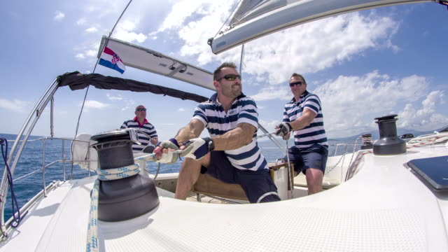 ws boat crew on a sailboat - team captain stock videos & royalty-free footage