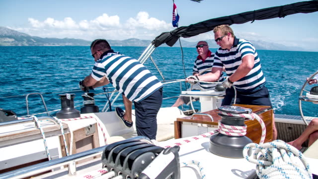 ms boat crew on a sailboat - tights stock videos & royalty-free footage