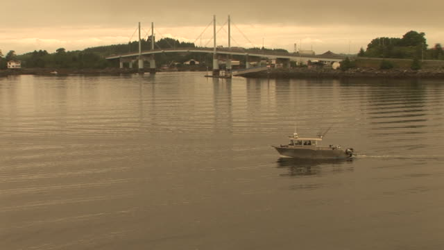 stockvideo's en b-roll-footage met ws, boat crossing sitka channel, o'connell bridge in background, alaska, usa - sepiakleurig