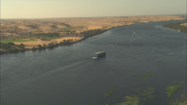 a boat cruises the river nile through the nile delta of egypt. - river nile stock videos & royalty-free footage
