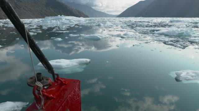 boat cutting through broken ice sheet, greenland - ice sheet stock videos & royalty-free footage
