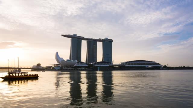 boat docking in marina bay at sunrise - marina bay singapore stock videos and b-roll footage