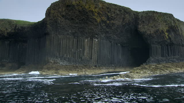 boat pov entrance to fingle's cave on isle of staffa, scotland - rock formation stock videos & royalty-free footage
