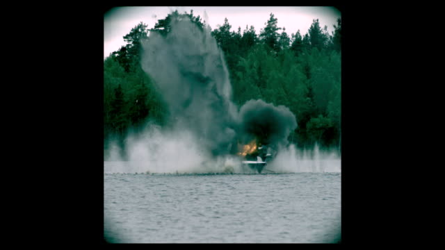 a boat explodes in smoke and flames. - fireball stock videos & royalty-free footage