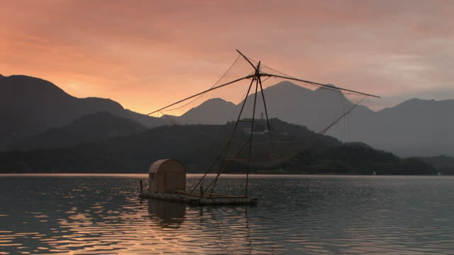 boat floating on sun moon lake in taiwan - sun moon lake stock videos and b-roll footage