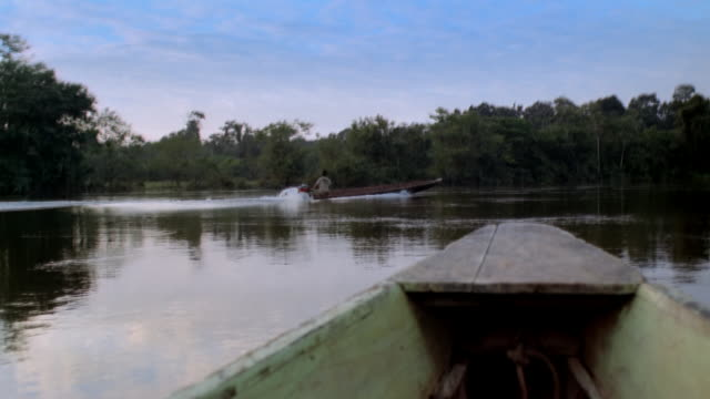pov boat floating on water, french guiana - french guiana stock videos & royalty-free footage