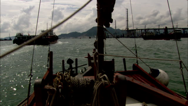 a boat floats in the south china sea near hong kong. available in hd. - south china sea stock videos & royalty-free footage