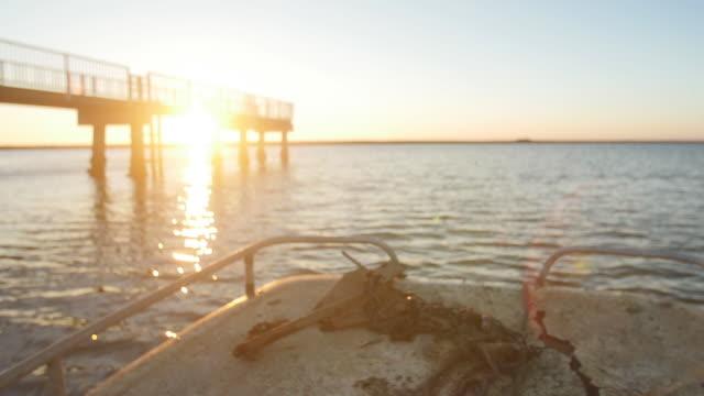 Boat Heading Out on Lake at Sunrise