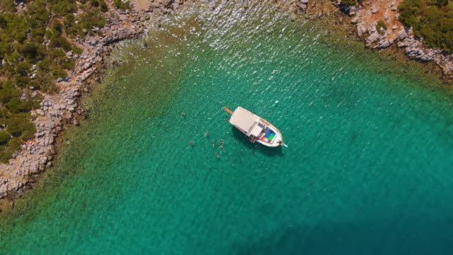 boat in a bay, mediterranean coast, turkey - inlet stock videos & royalty-free footage