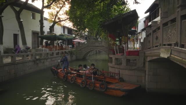 ws boat in canal, tongli, wujiang district, suzhou, jiangsu province, china - east china stock videos & royalty-free footage