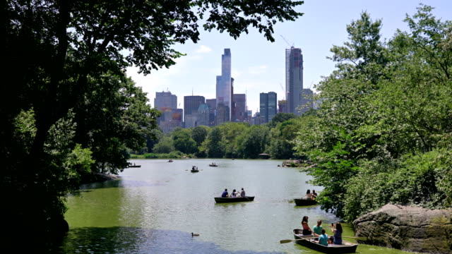 boat in central park. lake - scenics stock videos & royalty-free footage