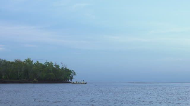 boat in distance at mouth of river near ocean - wiese stock videos & royalty-free footage