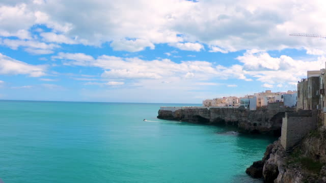 boat in polignano a mare - mare adriatico video stock e b–roll