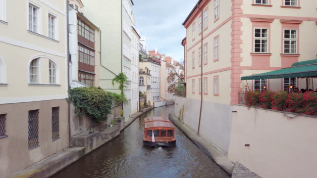 boat is in  canals of vltava river and charles bridge in prague in czech republic - vltava river stock videos & royalty-free footage