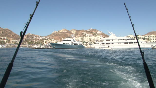 boat leaving cabo san lucas - cabo san lucas stock videos & royalty-free footage
