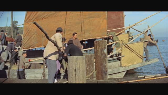 stockvideo's en b-roll-footage met ms boat leaving from pier / hong kong - breedbeeldformaat