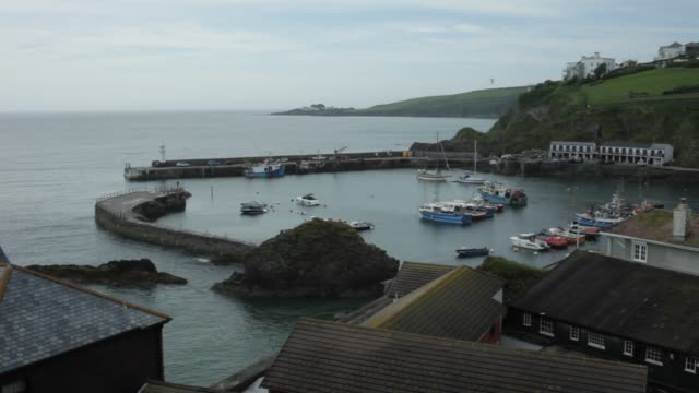 boat leaving harbour - cornwall england stock videos & royalty-free footage