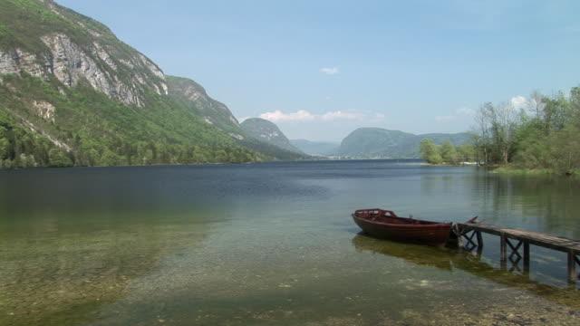 ws, boat moored in lake bohinj, triglav national park, slovenia - triglav national park stock videos and b-roll footage