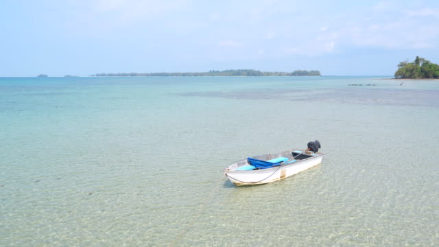 boat moored on beach with transparent water - recreational boat stock videos & royalty-free footage