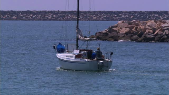 boat motoring out toward ocean