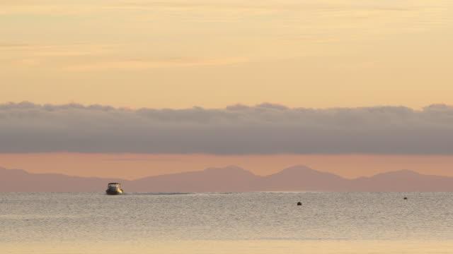 Boat moves on scenic horizon