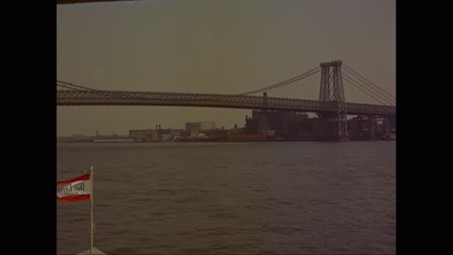 ws pov boat moving in east river toward manhattan bridge / new york city, new york state, united states - manhattan bridge stock videos and b-roll footage