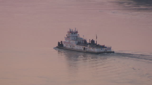 ms ts boat moving in hannibal mississippi river at sunset / hannibal, missouri, united states - mark twain stock videos & royalty-free footage