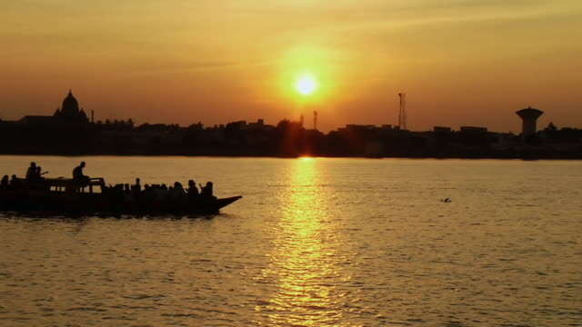 MS Boat moving in hooghly river at sunset / Kolkata, West Bengal, India