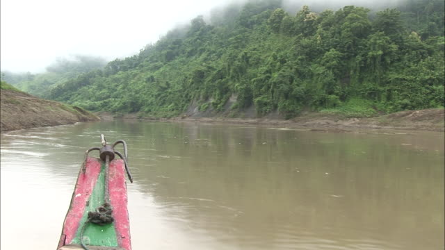pov - boat moving through calm tree lined river / bangladesh - hill stock videos & royalty-free footage