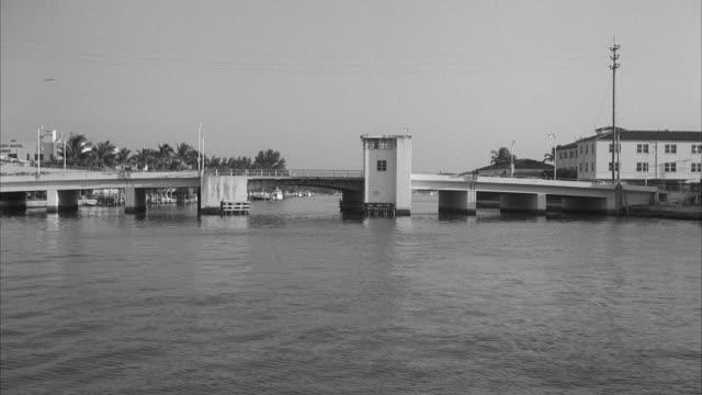 ws pov boat moving undar drawbridge  - drawbridge stock videos and b-roll footage