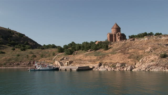 ws zi boat nearing akhatamar island and armenian cathedral of holy cross / lake van, van district, turkey - lake van stock videos and b-roll footage