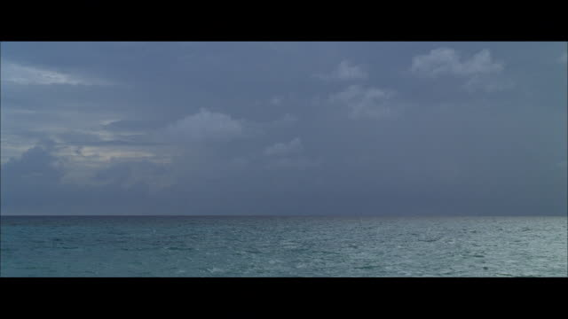 Boat POV of Ocean view with horizon with storm clouds