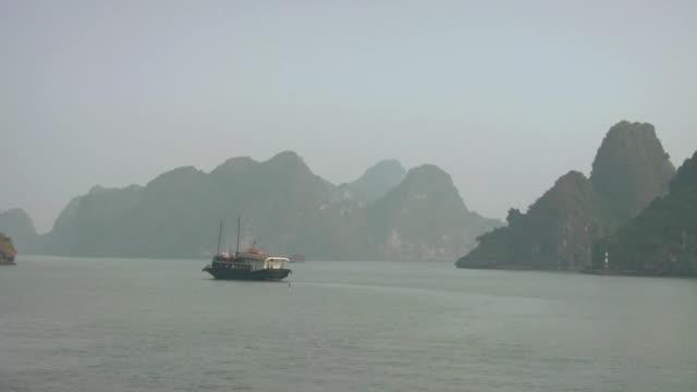 pan boat on ha long bay / quang ninh , vietnam - traditionally vietnamese stock videos & royalty-free footage