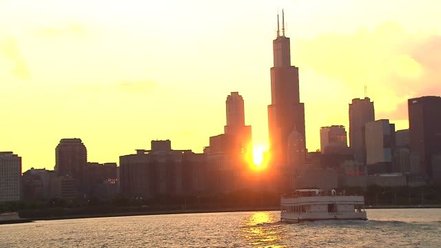 boat on lake michigan at sunset on july 20 2013 in chicago illinois - lake michigan stock videos & royalty-free footage