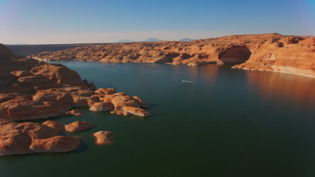 aerial boat on lake powell in the afternoon sun - lake powell stock videos & royalty-free footage