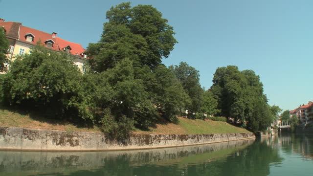 POV Boat on Ljubljanica River, Cobbler's Bridge and old part of town in background, Ljubljana, Slovenia