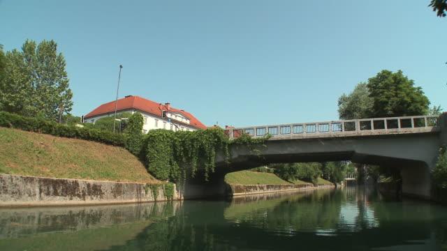 POV Boat on Ljubljanica River, passing under bridge, Ljubljana, Slovenia