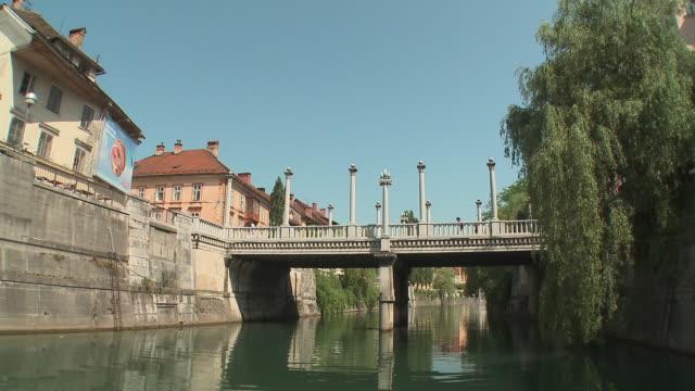 POV Boat on Ljubljanica River, passing under Cobbler's Bridge, Ljubljana, Slovenia