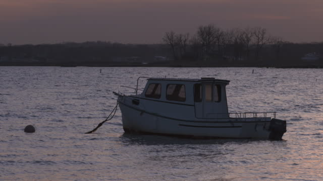 Boat on mooring in Sunset